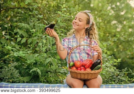 Kid Hold Basket With Vegetables Nature Background. Eco Farming. Girl Cute Smiling Child Living Healt