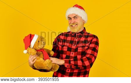 Santa Claus. Bearded Man Celebrate Christmas. Kind Hipster With Teddy Bear. Charity And Kindness. Lo