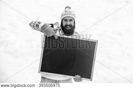 Look Here. Bearded Man In Warm Clothes. Happy New Year. Happy Hipster With Blackboard. Man Advertisi