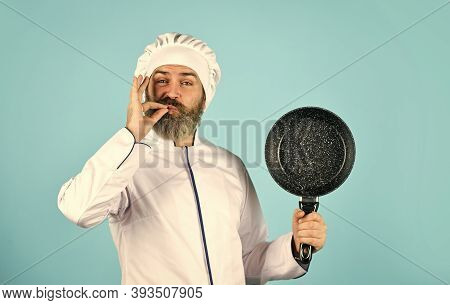 Healthy Food. Bearded Chef Preparing Breakfast. Frying Without Oil. Professional Kitchenware. Teflon
