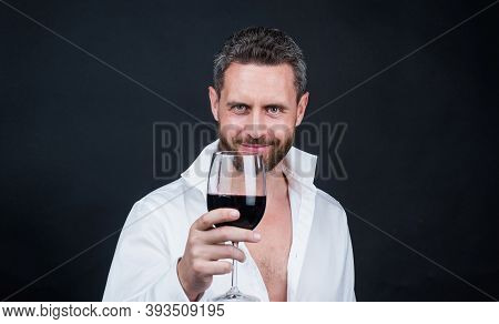 Sexy Man In Unbuttoned Shirt. Guy Drink Red Wine. Cheers For Happy Valentines Day. Alcohol Drinking.