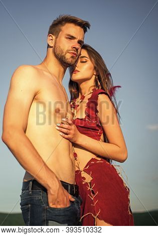 Sexy Couple In Love. Girl In Leather Clothes And Fit Muscular Man With Bare Torso. Summer Fest. Trad