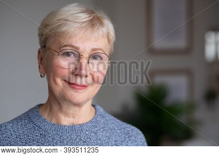 Senior Woman With Glasses, Looking At Camera, Smiling.