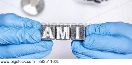 Ami Acute Myocardial Infarction - Word From Stone Blocks With Letters Holding By A Doctors Hands In