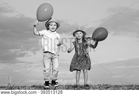 Kids Having Fun In Autumn Against Blue Sky. Child Playing Happy Childhood. Childhood On Countryside.