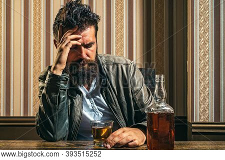 Man With Beard Holds Glass Brandy. Man Holding A Glass Of Whisky. Handsome Stylish Bearded Man. Drun