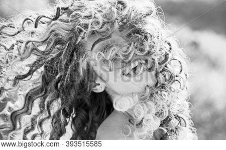 Blonde Spring Girl With Curly Beautiful Hair Smiling. Beauty Hair Salon. Fashion Haircut. Beauty Gir