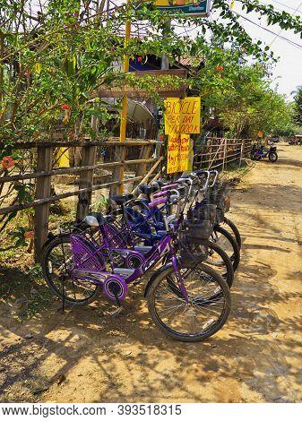 Mekong, Laos - 28 Feb 2012: Bikes On Mekong River, Champassak, Laos