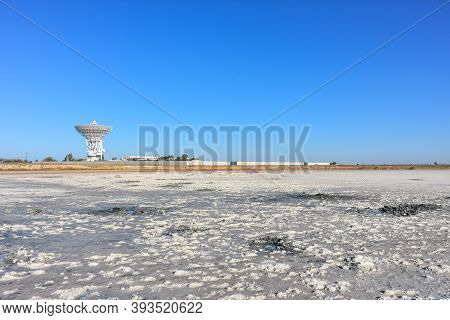 Landscape Of A Deserted Salt Lake. The Texture Of Salt Formations In The Foreground. Salt Lake Surfa