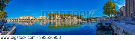Agde, France, July 19th 2020: Panorama View Of Herault River At The Town Agde With Buildings, Langue