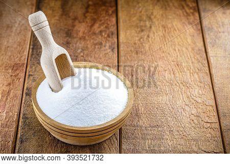 Baking Soda (baking Soda) In A Wooden Spoon, Rustic Background