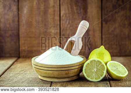 Bowl With Baking Soda And Citrus Fruits Like Lemon Or Orange Around. Home Remedy Against Stomach Aci
