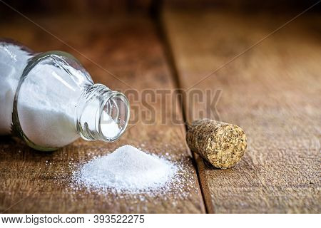 Baking Soda Glass With Open Lid. Rustic Wood Background