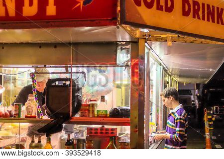 New Orleans, La - February 24: Parade Goer Orders Concessions At A Food Truck Along The Parade Route