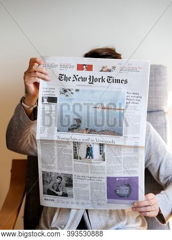 Paris, France - Nov 5, 2020: Woman Reading In Living Room The Latest Newspaper Featuring On Cover Pa