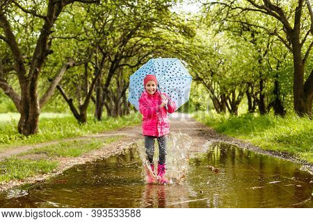 Little Girl Riding Bike In Water Puddle