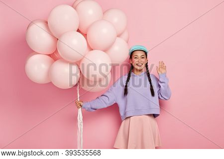Hi To You. Positive Chinese Woman Comes On Friends Birthday Party, Greets Fellows, Has Dark Hair Com