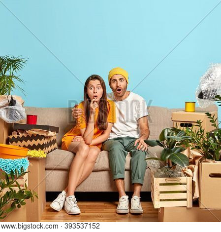 Startled Just Married Couple Remove In New Bought Apartment, Stare With Bugged Eyes At Camera, Get B