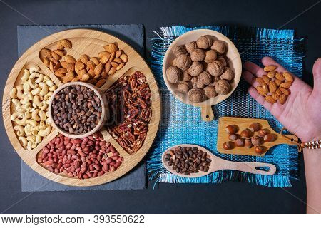 Wooden Bowl With Mixed Nuts. Healthy Food And Snack. Walnut, Peanuts, Almonds, Hazelnut And Cashews.