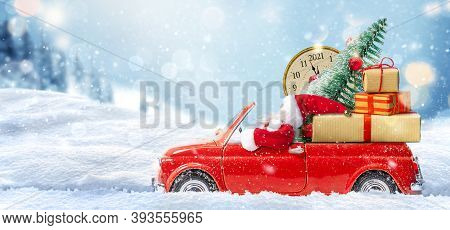 Christmas Is Coming. Santa Claus In Red Toy Car Delivering Gift For New Year 2021 And New Years Eve