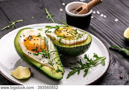 Healthy Breakfast. Avocado Stuffed With Eggs On The Table, Delicious Breakfast Or Snack, Food Recipe