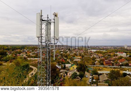 Aerial View Of Tower With 5g And 4g Cellular Network Antenna.