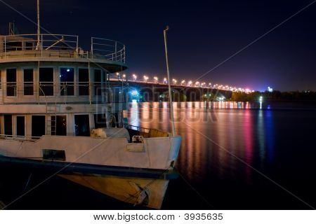 Ship And Bridge At Night