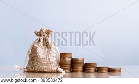 Coins In Sack And Coins Stack , Pension Fund, 401k, Passive Income, Investment And Retirement Concep