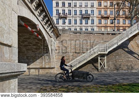 Lyon, France, March 3, 2019 : Cycling On Berges Du Rhone.  Quays, Streets, Cycling And Walking Paths