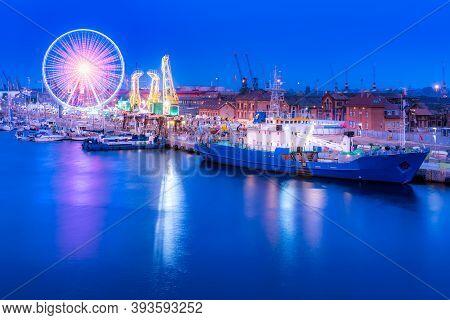 Ships, Cranes Called Dzwigozaury And Amusement Park At Odra River Boulevards In Szczecin. Crowds Enj