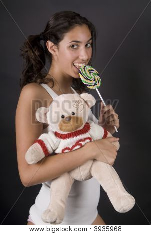 Girl Eating A Large Lolly Pop