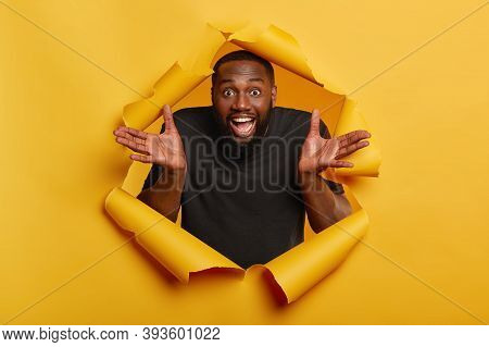 Merry Black Man Spreads Palms, Has Joyous Expression, White Teeth, Makes Decision, Gets Unexpected O