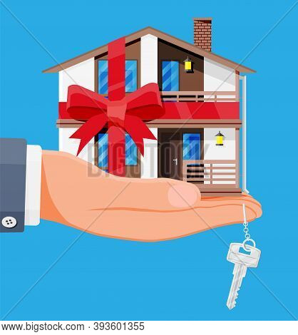 Suburban Family House In Hand With Ribbon And Bow. Countryside Wooden House Building Gift Icon. Real