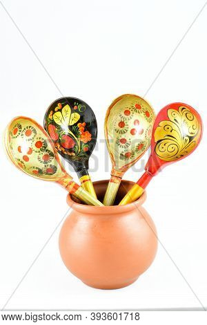 Small Brown Clay Pot For Sauces, Soups, Kitchen Item, Wooden Food Spoons, On White Background