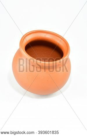 Small Brown Clay Pot For Sauces, Soups, Kitchen Item, On A White Background