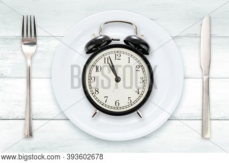 Time To Eating Or Intermittent Fasting Concept - Flat Lay Composition With Alarm Clock, Plate And Ut