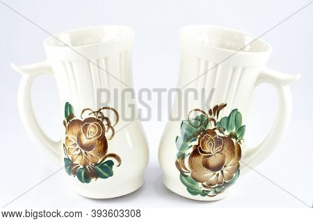 Two Jugs, With A Handle, Decorated With Flower Ornaments, White Background