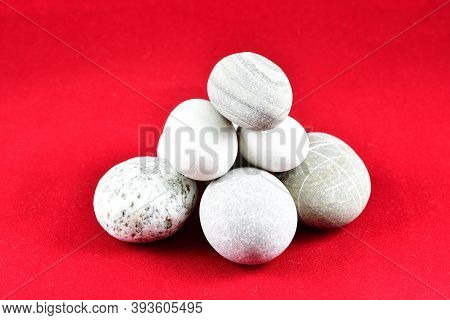 Small Sea Stones Piled Together, Composition, Decoration, Red Background