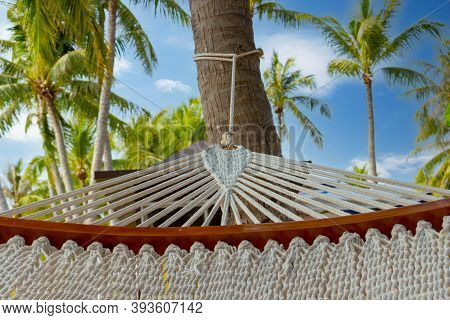 Hammock On A Tropical Resort. Hammock Among Palm Trees On The Beach. Holiday And Vacation Concept.