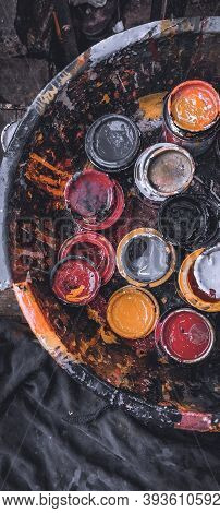 Paint Cans Color Palette. Paint Cans Splashing Different Bright Colors. Flat Lay Composition With Pa
