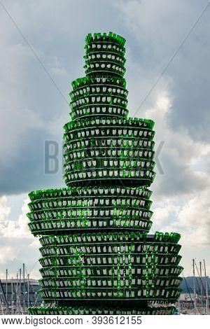 Gijon, Asturias, Spain - 10 October, 2020: Monument To The Cider, Made Of Cider Bottles, Port, Marin