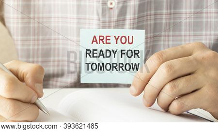 Closeup On Businessman Holding A Card With Text Are You Ready For Tomorrow, Business Concept Image W