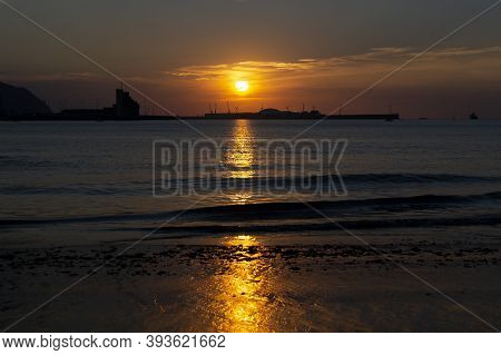 Sunset With Orange Color In The Sky At Getxo-guecho Beach. Spanish Municipality Located On The Coast
