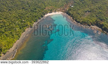 Sea Bay With Turquoise Water And A Small White Beach.coast Of The Island Of Camiguin, Philippines.be