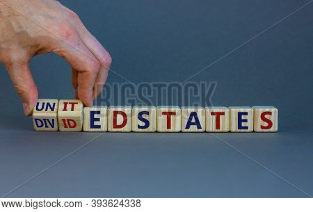 United Or Divided States Of Amerika. Male Hand Flips Wooden Cubes And Changes The Inscription 'unite