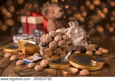 Dutch Holiday Sinterklaas. Kruidnoten Cookies Sweets, Chocolate And A Gift For The Child. Children P