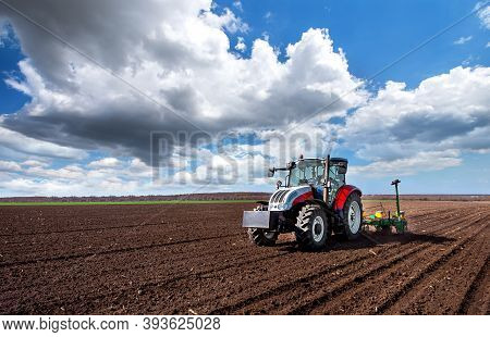 Farmer Seeding, Sowing Crops At Field. Tractor!