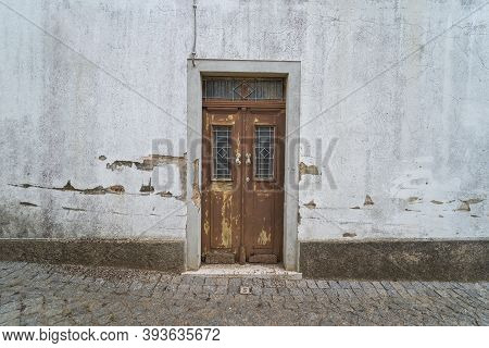 Retro Old Facade Vintage Style Brown Exterior House Door From Portugal Or Spain. Street With Traditi