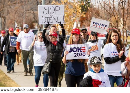 Helena, Montana / Nov 7, 2020: Pro Trump Supporters At Stop The Steal Rally Holding Signs Against Th