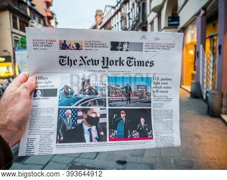 Paris, France - Nov 5, 2020: Pov Male Hand With Latest Newspaper The New York Times Featuring On Cov